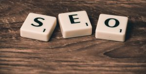 squares with letters on a table spelling SEO
